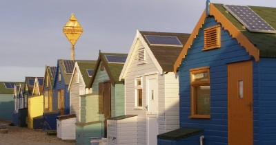 Solar panels on beach huts at Mudeford Spit (courtesy Wikimedia)